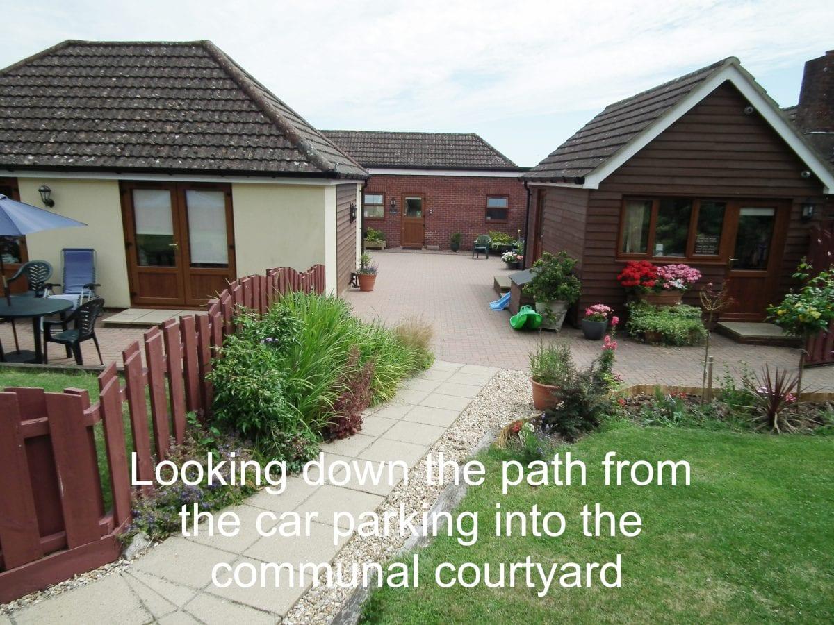 path into communal courtyard